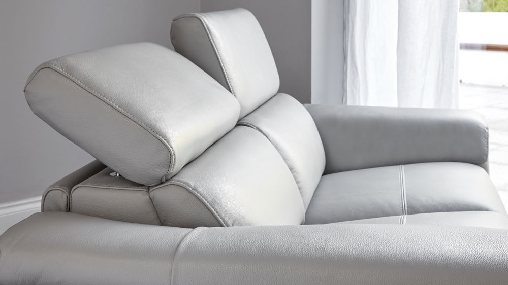 Leather sofa with adjustable headrest