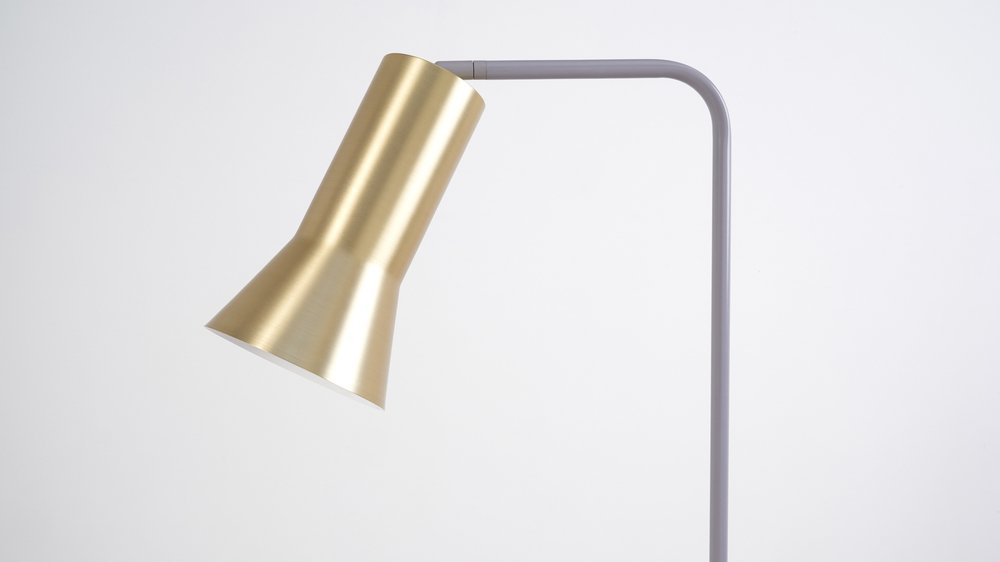 Light brass and light grey table lamp