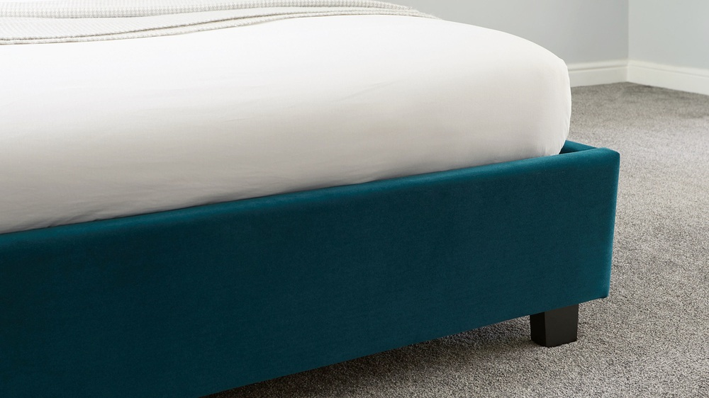 panelled teal headboard ottoman bed