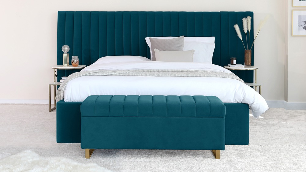 teal and brass bedroom storage