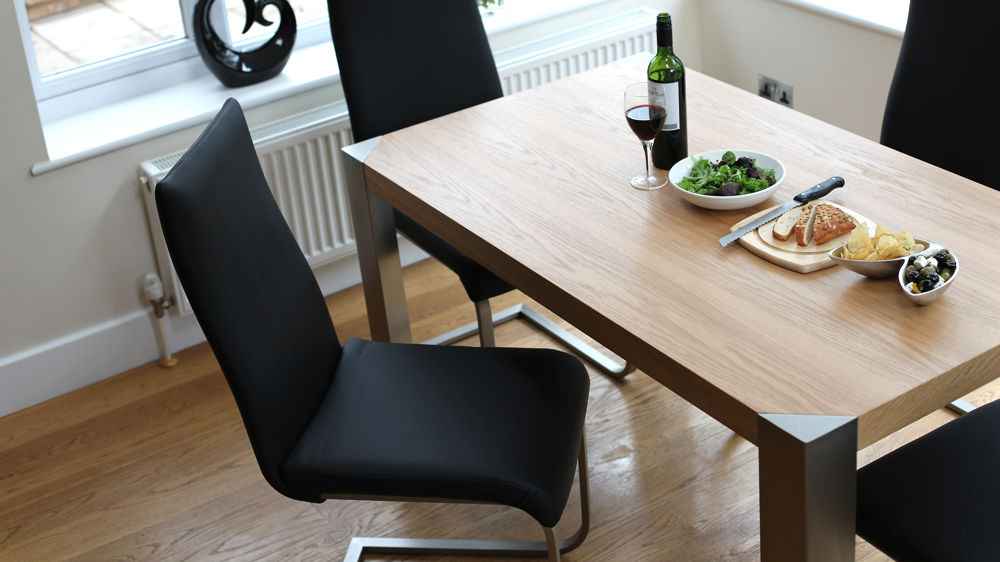 Black Swing Chairs and Oak Dining Table