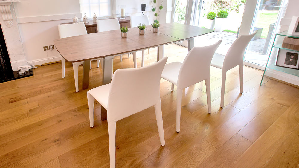 White Dining Chairs and Wooden Extending Dining Table