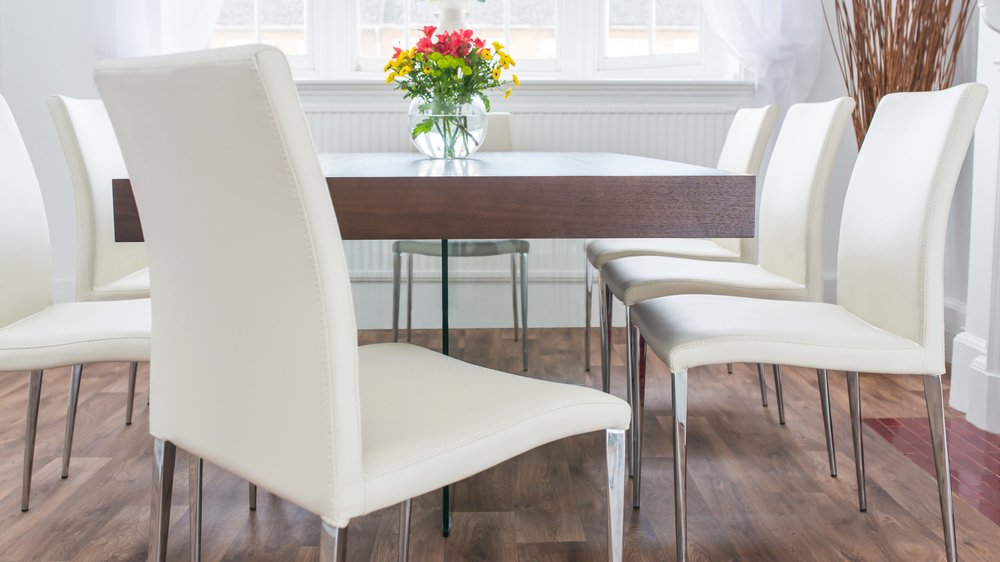 Large Glass Based Dining Table with White Dining Chairs