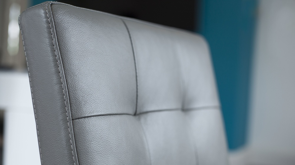 Grey Quilted Real Leather Cantilever Dining Chair