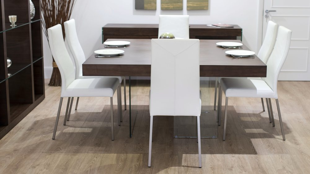 White Dining Chairs and Dark Wood and Glass Dining Table