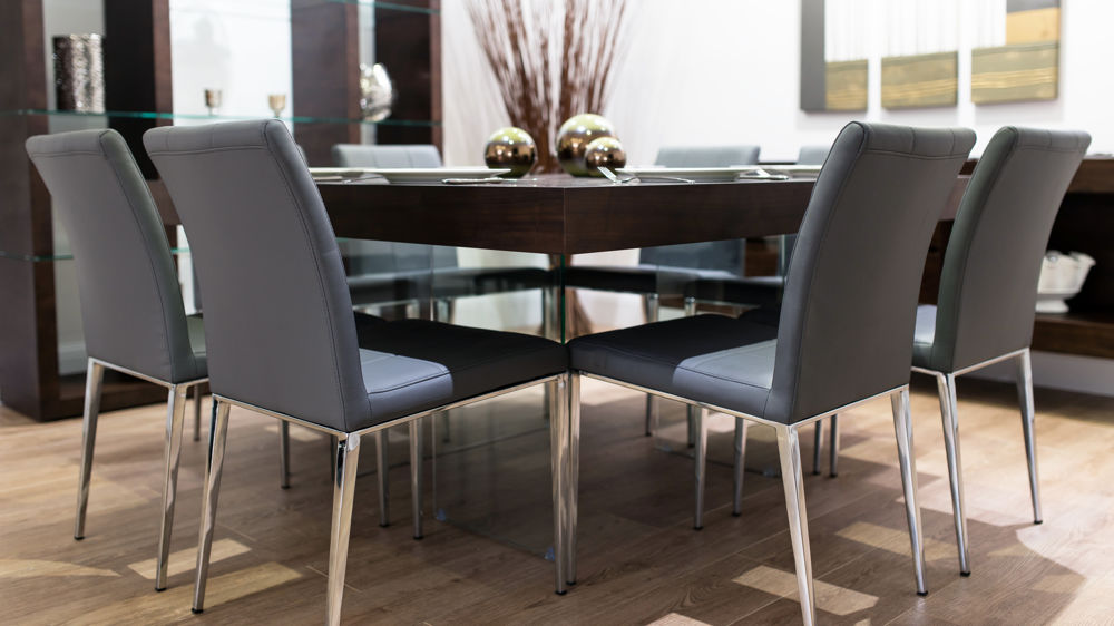 Stylish Glass Based Dining Table and Grey Dining Chairs