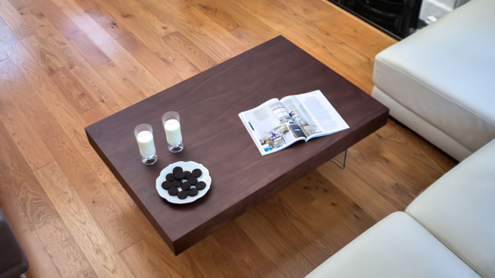 dark wood veneer and tempered glass coffee table
