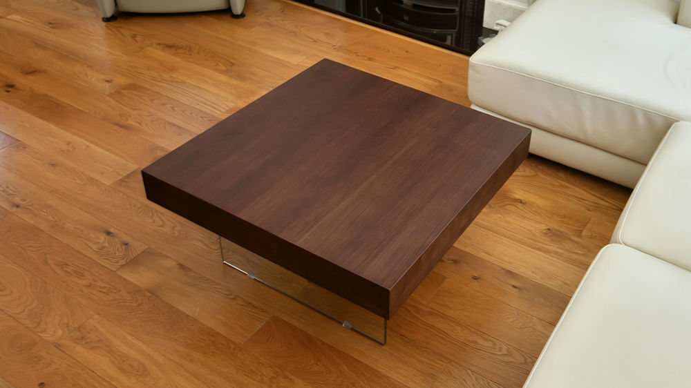 Small square dark wood and glass coffee table
