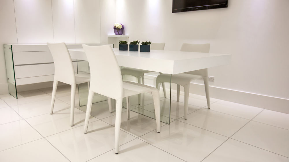 White Dining Table with Glass Legs and Modern Dining Chairs