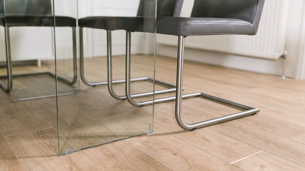 Modern Cantilever Dining Chairs and Glass Based Dining Table