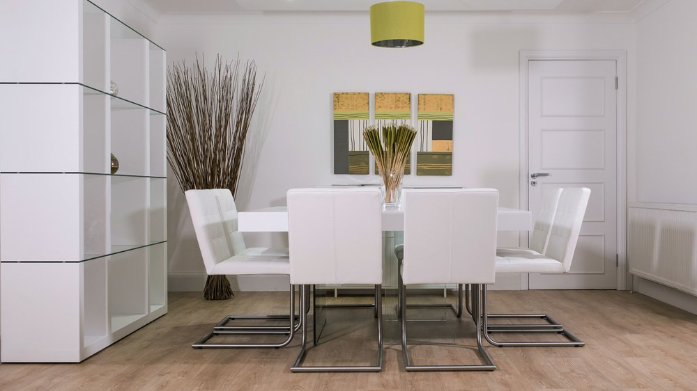 White Cantilever Dining Chairs and Glass Based Dining Table