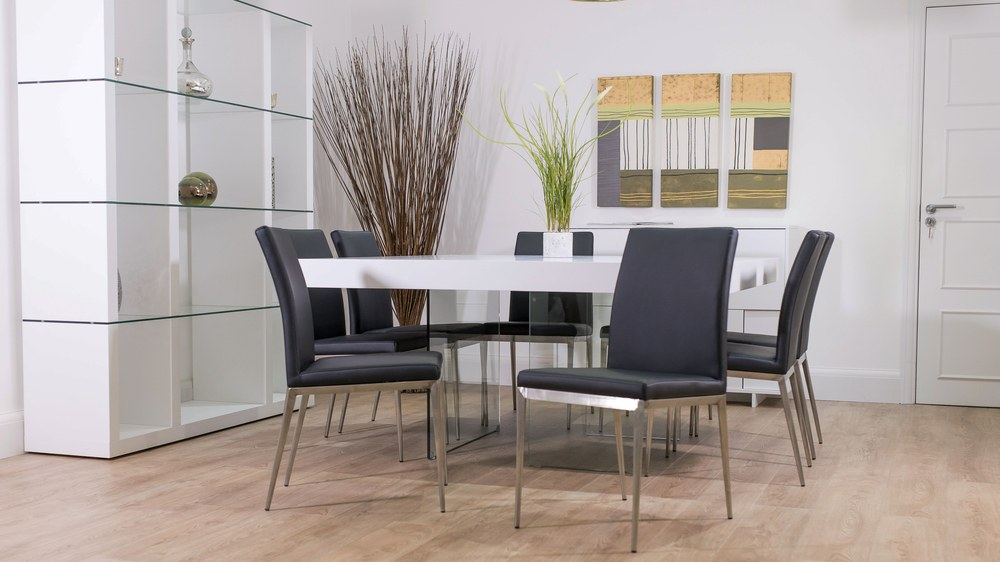 Large Glass Based Dining Table with Black Dining Chairs