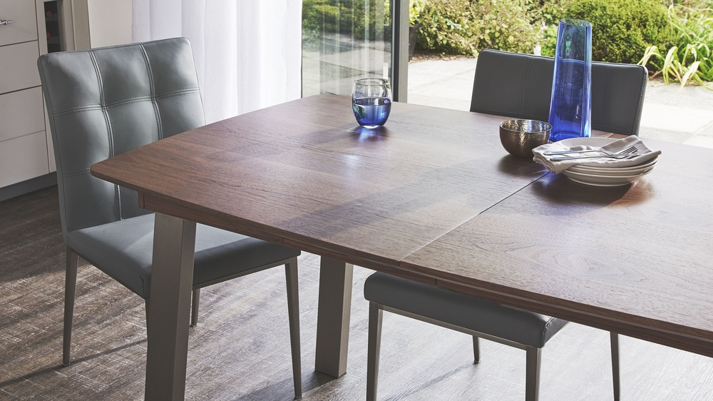 Contemporary White Dining Chairs and walnut Extending Dining Table