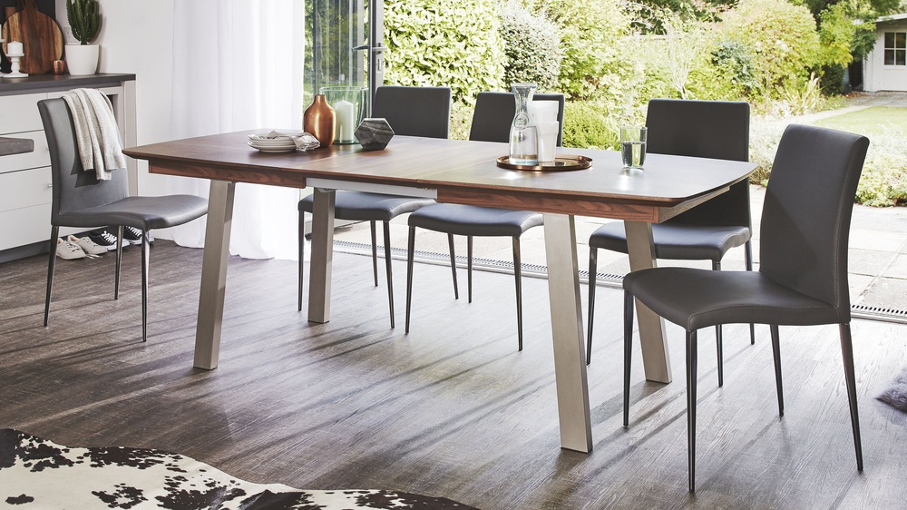 Extending wooden dining table set