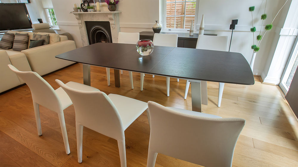 Extending dark wood seater dining table brushed metal