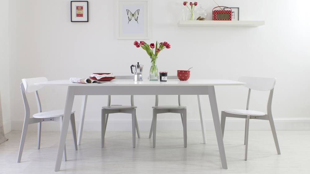 Grey and white table with a butterfly extension