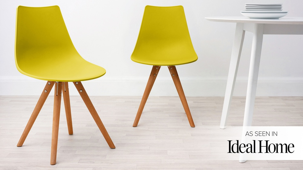 yellow plastic eames style chair
