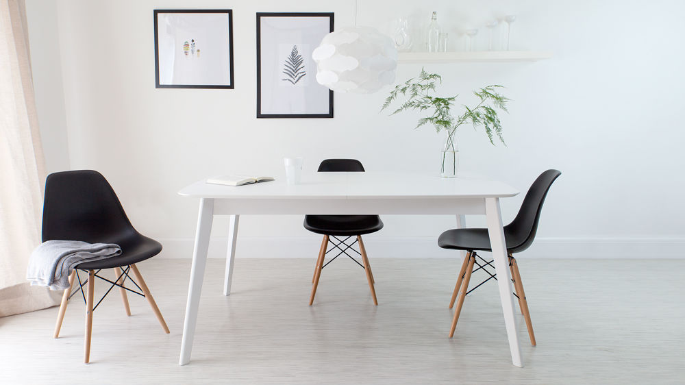 Black Eames Chairs and White Extending Dining Table