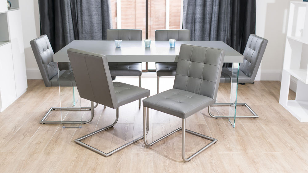 Quilted Leather Swing Dining Chairs and Floating Dining Table
