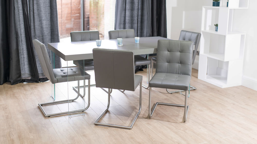Contemporary Glass Based Grey Dining Table and Swing Chairs