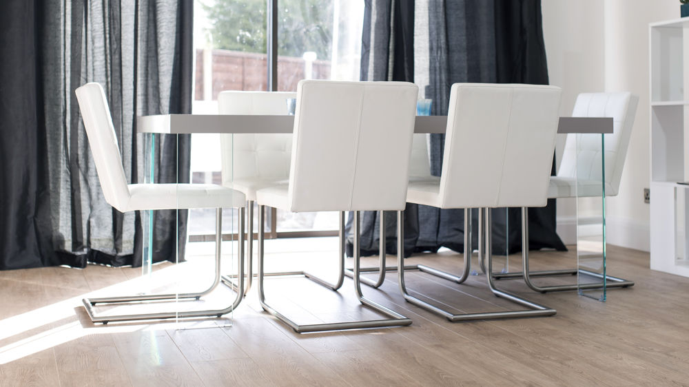 Cantilever Dining Chairs and Glass Based Dining Table