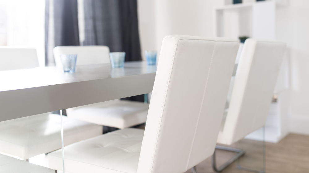 White Dining Chairs and Grey Wood Dining Table