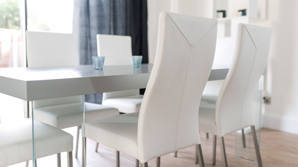 Stylish White Dining Chairs with Glass Based Dining Table