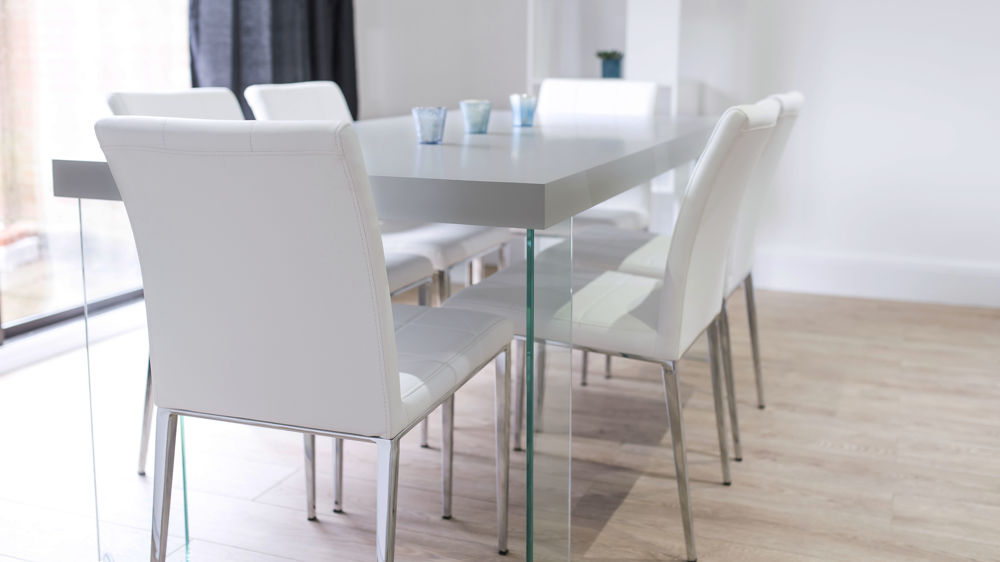 Stylish Dining Chairs with a Glass Based Dining Table