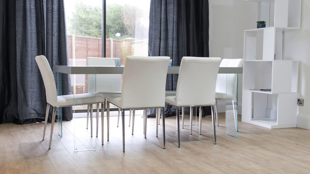 Modern Floating Dining Table and Quilted Leather Dining Chairs