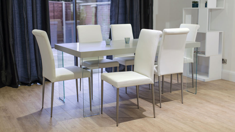 White Premium Leather Dining Chairs and Glass Based Dining Table