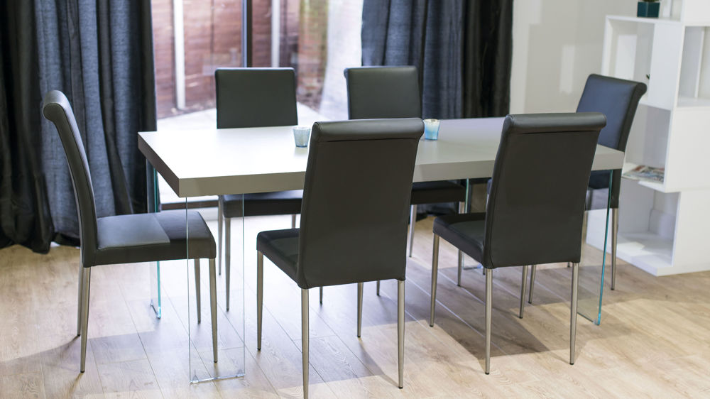 Stylish Black Dining Chairs and Glass Based Dining Table