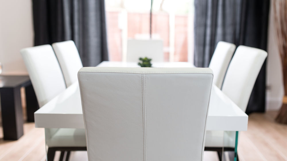 Comfortable Dining Chairs and Large White Gloss Dining Table