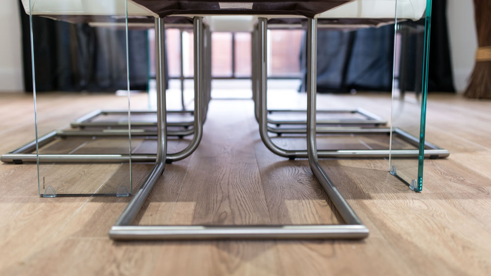 Cantilever Dining Chairs and Glass Legged Dining Table