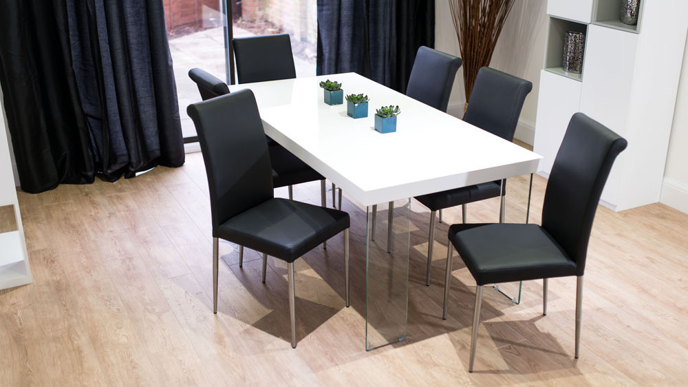 Black Dining Chairs and Floating White Gloss Dining Table