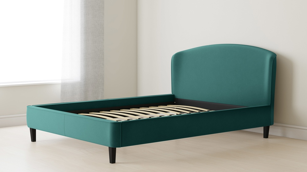 simple velvet bed with wood legs
