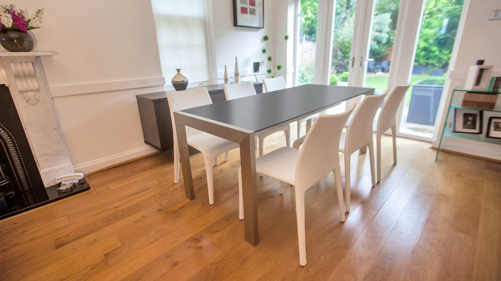 Large Black and Brushed Metal Legged Dining Table and Stackable Chairs