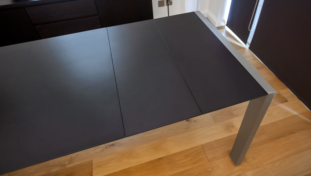 Large Black Extending Dining Table with Brushed Metal Legs