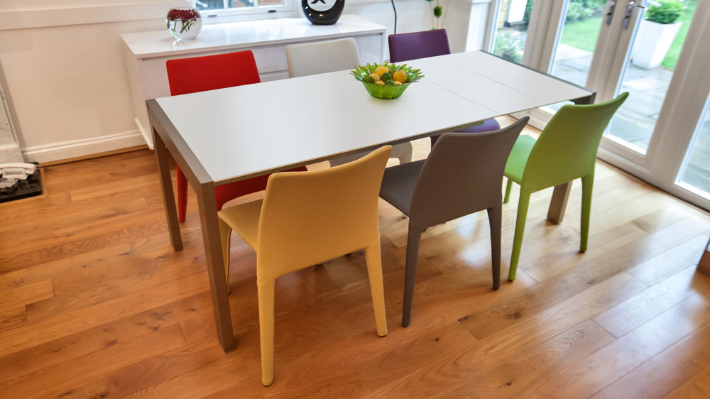 Modern White Dining Table with Multi- Coloured Dining Chairs