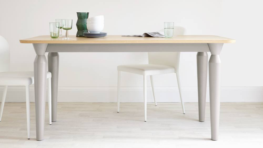 White dining table with oak top that seats 6