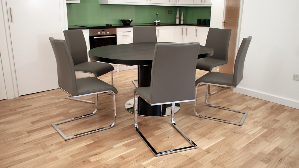 Modern Round Black Extending Dining Table and Cantilever Chairs