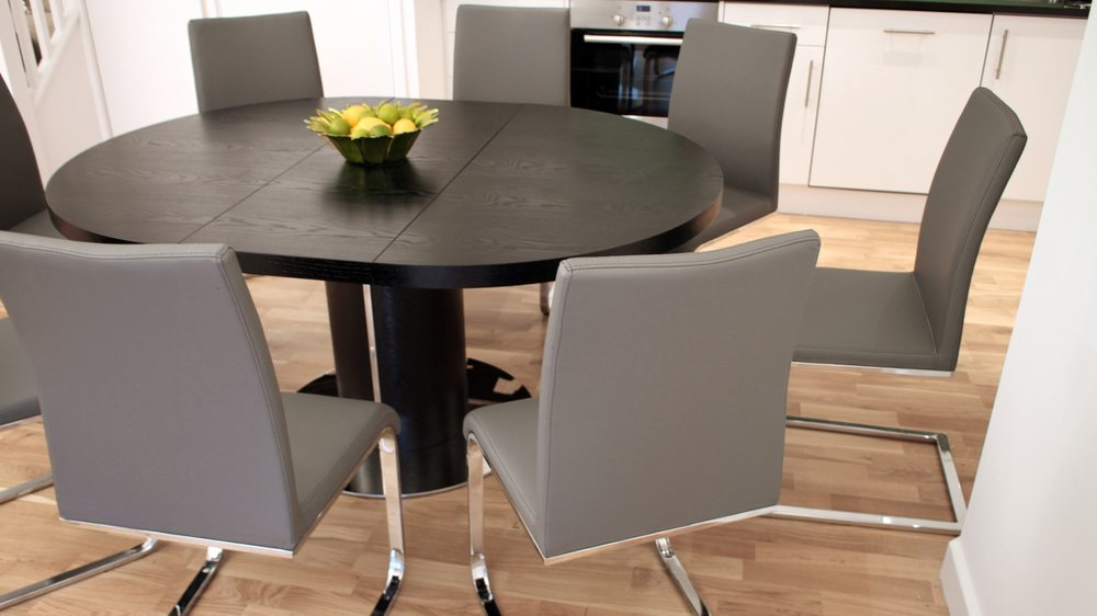 Comfortable Grey Swing Dining Chair and Round Extending Dining Table