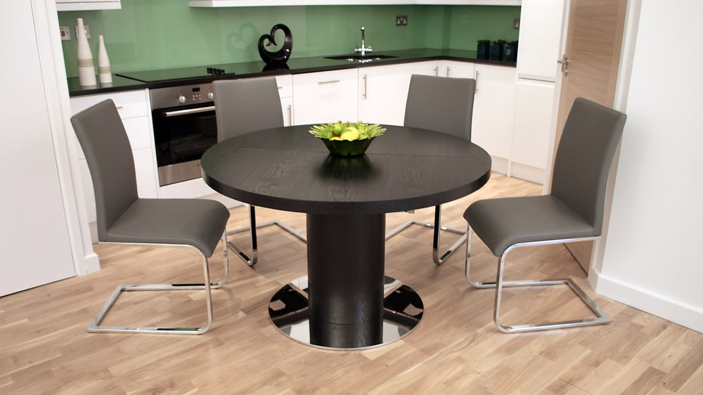 Grey Cantilever Dining Chairs And Round Extending Dining Table