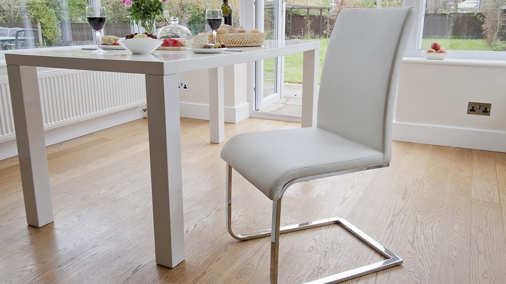 White Leather and Chrome Legged Cantilever Dining Chairs