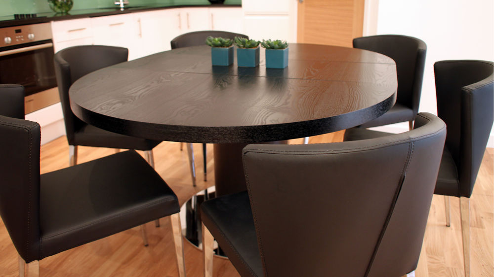 Modern round black ash extending dining set trendy black for Modern black dining table