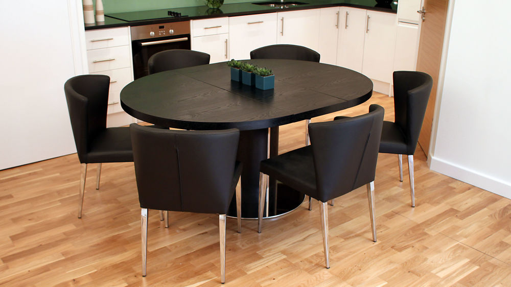 Modern round black ash extending dining set trendy black for Trendy dining sets