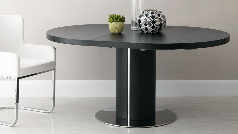 Home Tables Dining Tables Curva Round Black Ash Extending Dining Table