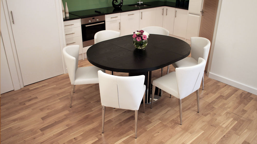 Round Black Extending Dining Table and White Dining Chairs