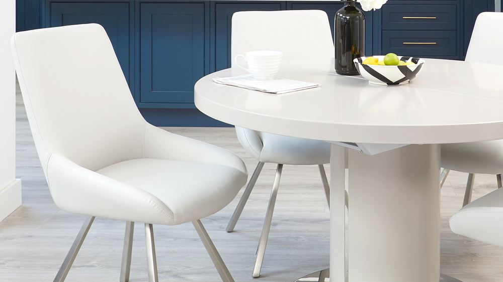 Modern round extending dining tables with chrome base