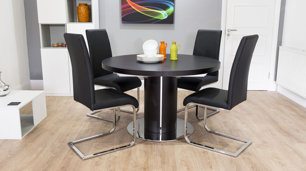 Black Cantilever Dining Chairs with Large Round Extending Table