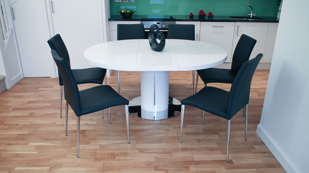 large round white gloss extending dining table and black dining chairs - White Gloss Kitchen Table
